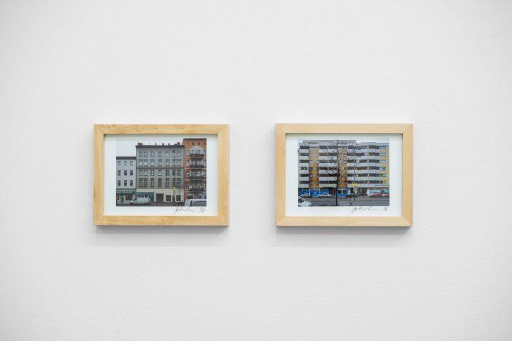 John Reardon, Action to produce a high degree of uncertainty, 2017 (two photographs - each limited edition of 5) These two photographs document and form part of an exchange the artist had with residents of the apartment block - opposite Å+ gallery - about the gallery, about what art can be. Residents involved in this exchange were given a limited edition print of Å+ gallery (taken from the apartment block) in exchange for attaching a single plastic bag (from the nearby grocery store), to their balcony for the duration of the exhibition or until the bag is removed by natural or unnatural forces. The other photograph of the apartment block (taken from Å+ gallery and with some bags still attached to balconies) is available for sale through Å+ gallery