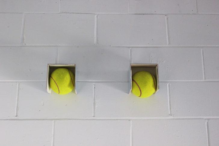 <i>Balls</i> 2010, Oversized tennis balls, tiles, silicon, 2010.  19 x 62 x 15 cm